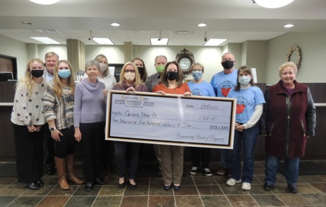 Group of Community Bank of Peculiar Employees donating to Caring Hearts of Peculiar