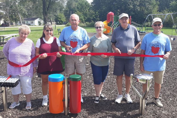 Ribbon cutting for the musical ensemble playset now featured in Peculiar's McKernan Park.