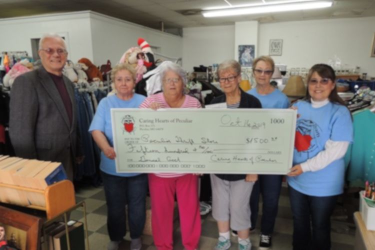 Caring Hearts of Peculiar presenting check to Peculiar Thrift Store.